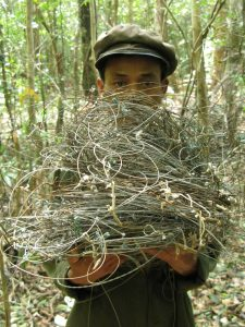 Patrol team member with wires snares collected in Nakai-Nam Theun National Protected Area, Lao PDR.
